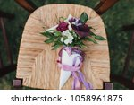 bouquet of flowers and greens... | Shutterstock . vector #1058961875
