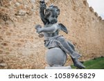 statue stands against the... | Shutterstock . vector #1058965829