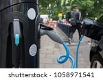 electric vehicle charging... | Shutterstock . vector #1058971541