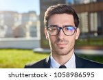 young businessman in eyeglasses ... | Shutterstock . vector #1058986595