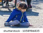 little girl in blue coat and... | Shutterstock . vector #1058986835