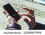 detailed view on the hands of a ... | Shutterstock . vector #1058987999