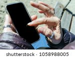 woman using mobile phone.... | Shutterstock . vector #1058988005