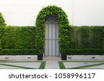 arched arch in a park covered... | Shutterstock . vector #1058996117