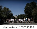 tourists wait in a queue to...   Shutterstock . vector #1058999435