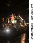 Small photo of New Orleans, LA - February 9, 2018: The Krewe of Hermes and the Krewe D'Etat showcase their parade down St. Charles Avenue in New Orleans, LA for the Carnival Season.