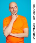 handsome bald male with pensive ... | Shutterstock . vector #1059007901