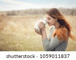 Stock photo the girl with the rabbit happy little girl holding cute fluffy bunny friendship with easter bunny 1059011837