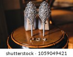 wedding rings of bride and... | Shutterstock . vector #1059049421