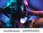 halloween beautiful sexy young... | Shutterstock . vector #1059053501