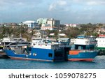 Small photo of The view of Potters Cay industrial island cargo ships in Nassau, the capital of The Bahamas.