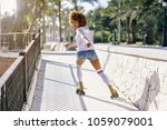 young black woman on roller... | Shutterstock . vector #1059079001
