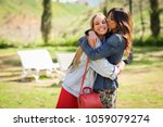 young woman kissing her friend... | Shutterstock . vector #1059079274