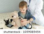doctor and boy patient... | Shutterstock . vector #1059085454