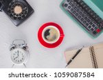 a cup of coffee with typewriter ... | Shutterstock . vector #1059087584