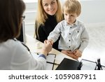 pediatrician meeting with... | Shutterstock . vector #1059087911