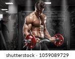 muscular man working out in gym ... | Shutterstock . vector #1059089729
