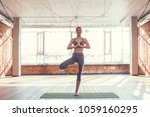 young girl practicing yoga in... | Shutterstock . vector #1059160295