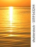 orange sun over the sea horizon ... | Shutterstock . vector #1059163244