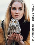 blonde woman with an owl in her ... | Shutterstock . vector #1059170624