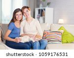 homosexual couple of lesbian... | Shutterstock . vector #1059176531