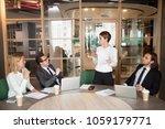 businesswoman presenting... | Shutterstock . vector #1059179771