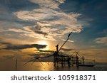 fisherman get fishing nets from ... | Shutterstock . vector #105918371