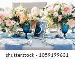 long dinner tables covered with ... | Shutterstock . vector #1059199631