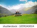 happy family sitting on a bench ... | Shutterstock . vector #1059243014