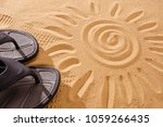 slippers sands on the beach in... | Shutterstock . vector #1059266435