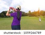 golfer woman hit shot swing on... | Shutterstock . vector #1059266789