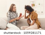 excited woman getting gift from ... | Shutterstock . vector #1059281171