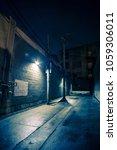 dark and eerie urban city alley ... | Shutterstock . vector #1059306011
