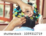 perm in the beauty salon  close ... | Shutterstock . vector #1059312719
