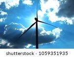 silhouette wind turbine... | Shutterstock . vector #1059351935