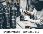 industrial worker in... | Shutterstock . vector #1059360119