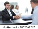 handshake business partners at... | Shutterstock . vector #1059362267