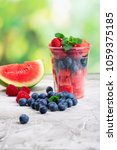 plastic cup full of fresh cut... | Shutterstock . vector #1059375185