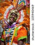 Small photo of NASSAU, THE BAHAMAS - JANUARY 1 - Entertaining male dancer who represents the sun, in Junkanoo, street festival in Nassau on January 1, 2011