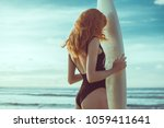 surf girl with long hair go to... | Shutterstock . vector #1059411641