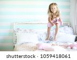 young girl reads a book young...   Shutterstock . vector #1059418061