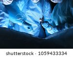 closeup of surgeons performing... | Shutterstock . vector #1059433334