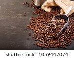 coffee beans in a sack on dark... | Shutterstock . vector #1059447074