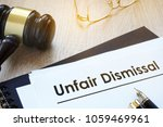 Small photo of Documents unfair dismissal and gavel in a court.