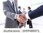closeup.reliable handshake of... | Shutterstock . vector #1059480071