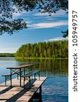 wooden pier on lake with... | Shutterstock . vector #105949757