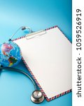 Small photo of World health day ,Stethoscope wrapped around globe on pastel blue background. Save the wold, Global health care and Green Earth day concept