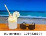 refreshing lemon drink on a... | Shutterstock . vector #1059528974