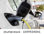 electric car refuel with power | Shutterstock . vector #1059534041