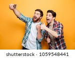 portrait of a two excited young ... | Shutterstock . vector #1059548441